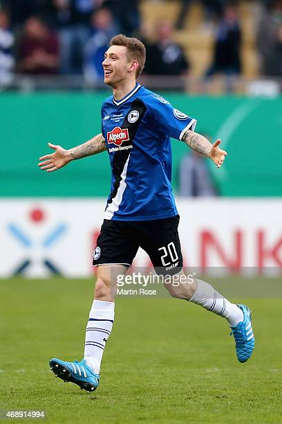 Manuel Junglas of Arminia Bielefeld celebrates as he scores the opening goal during the DFB Cup Quarter Final match between Arminia Bielefeld and...