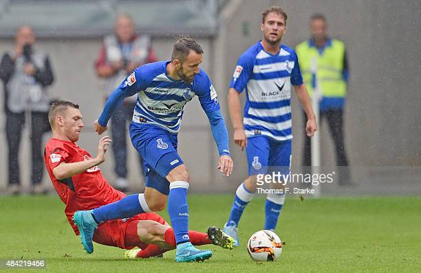 Manuel Junglas of Bielefeld tackles Zlatko Janjic of Duisburg during the Second Bundesliga match between MSV Duisburg and Arminia Bielefeld at...