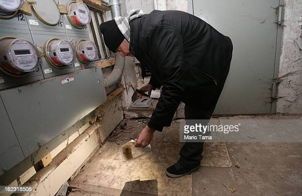 Manuel 'Junior' Medina an exterminator for MM Environmental inspects a basement for rats in Manhattan's Lower East Side on February 21 2013 in New...