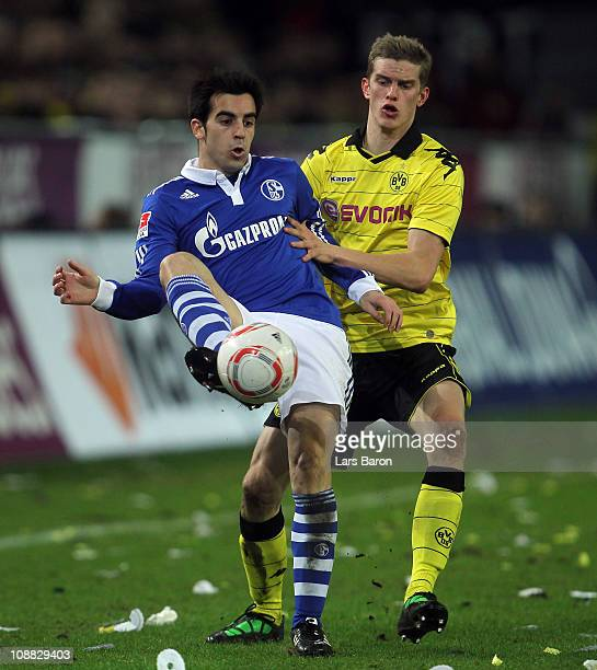 Manuel Jurado of Schalke is challenged by Sven Bender of Dortmund during the Bundesliga match between Borussia Dortmund and FC Schalke 04 at Signal...