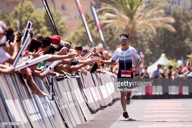 Manuel Kung of Switzerland celebrates as he finishes in 2nd place Ironman 703 Italy race on June 18 2017 in Pescara Italy