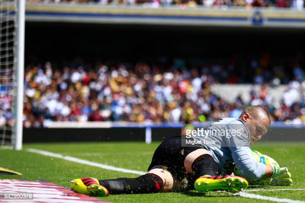 Manuel Lajud goalkeeper of Xolos dives for the ball during the 7th round match between Pumas UNAM and Tijuana as part of the Torneo Clausura 2017...