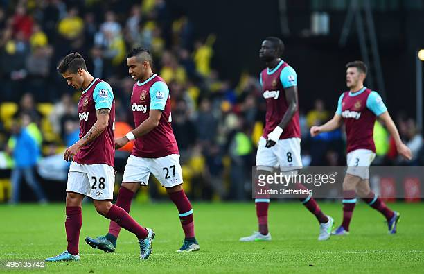 Manuel Lanzini Dimitri Payet Cheikhou Kouyate and Aaron Cresswell of West Ham United look dejected after conceding during the Barclays Premier League...