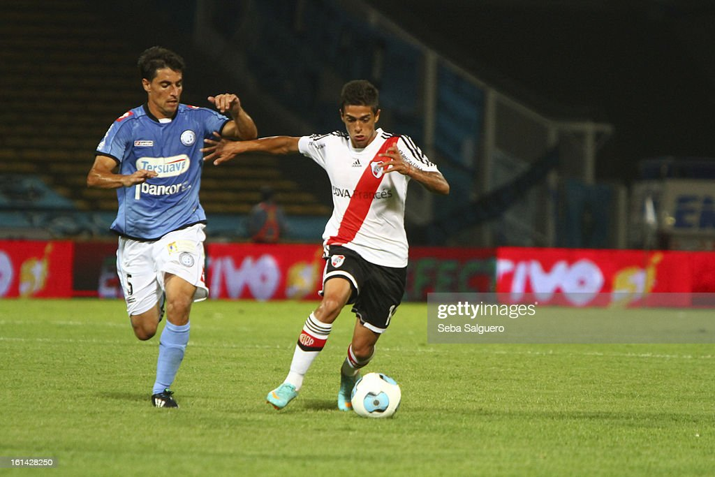 Manuel Lanzini Moris of River fights for the ball with Guillermo Farre of Belgrano during the match between Belgrano and River for the Torneo Final 2013 on February 10, 2013 in Cordoba, Argentina.