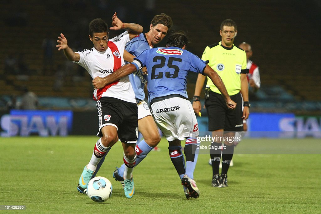 <a gi-track='captionPersonalityLinkClicked' href=/galleries/search?phrase=Manuel+Lanzini&family=editorial&specificpeople=7150862 ng-click='$event.stopPropagation()'>Manuel Lanzini</a> Moris of River fights for the ball with Guillermo Farre of Belgrano during the match between Belgrano and River for the Torneo Final 2013 on February 10, 2013 in Cordoba, Argentina.