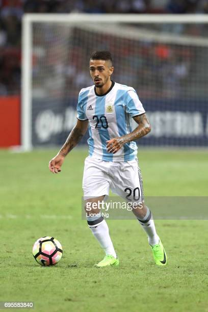 Manuel Lanzini of Argentina dribbles the ball during the international friendly match between Argentina and Singapore at National Stadium on June 13...
