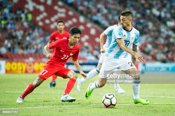 Manuel Lanzini of Argentina fights for the ball with Nazrul Nazari of Singapore during the International Test match between Argentina and Singapore...