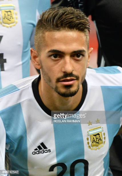 Manuel Lanzini of Argentina poses before the start of their international friendly football match against Singapore at the National Stadium in...