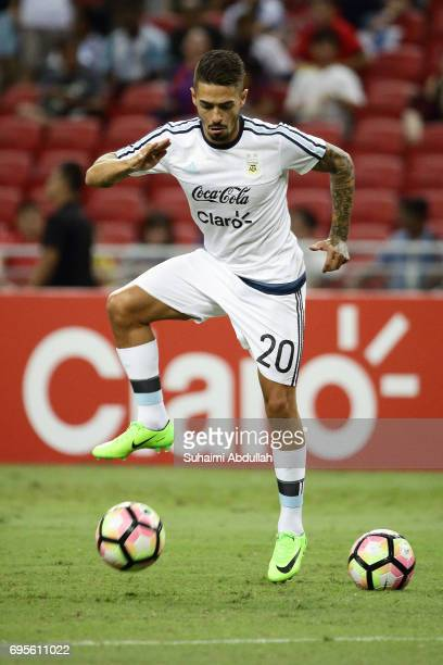 Manuel Lanzini of Argentina warms up before the International Test match between Argentina and Singapore at National Stadium on June 13 2017 in...