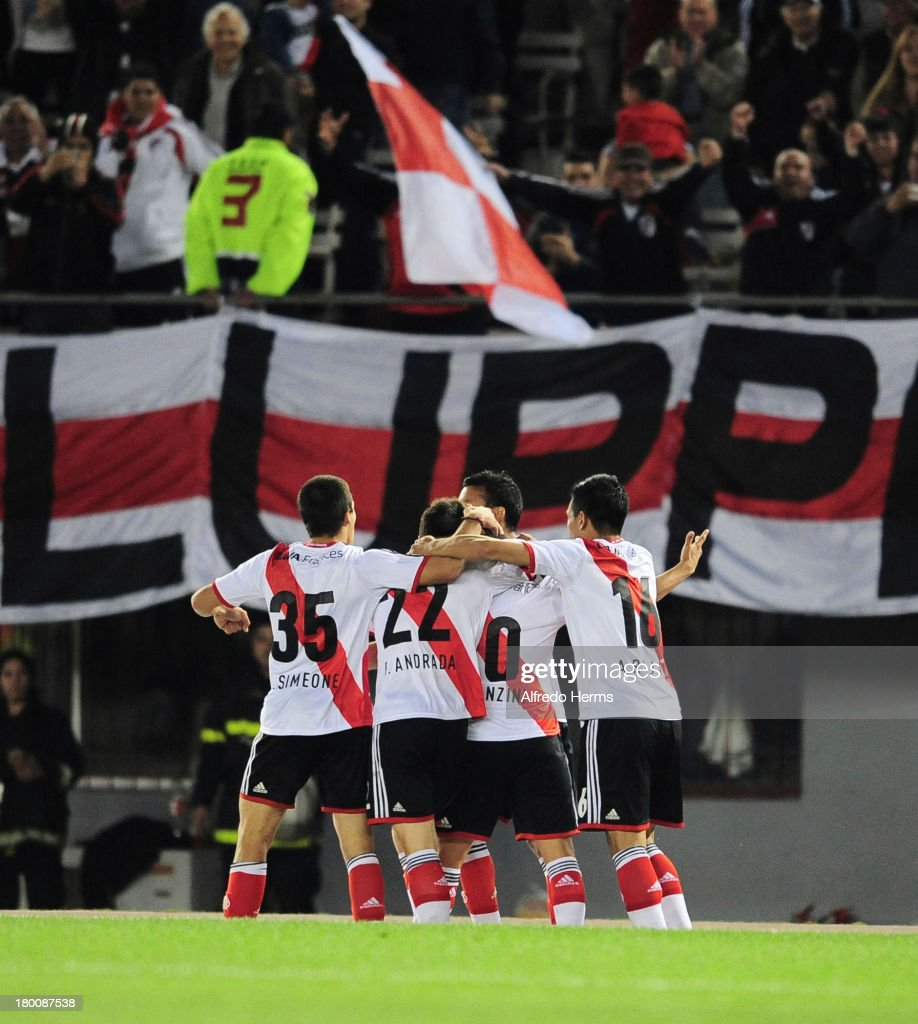 <a gi-track='captionPersonalityLinkClicked' href=/galleries/search?phrase=Manuel+Lanzini&family=editorial&specificpeople=7150862 ng-click='$event.stopPropagation()'>Manuel Lanzini</a> of River Plate celebrates a scored goal with teammates during a match between River Plate and Tigre as part of the 6th round of the Torneo Inicial 2013 at Monumental Stadium on September 08, 2013 in Buenos Aires, Argentina.