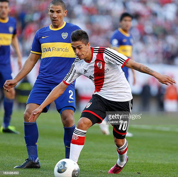 Manuel Lanzini of River Plate drives the ball during a match between River Plate and Boca Juniors as part of the Torneo Inicial 2013 at the Antonio...