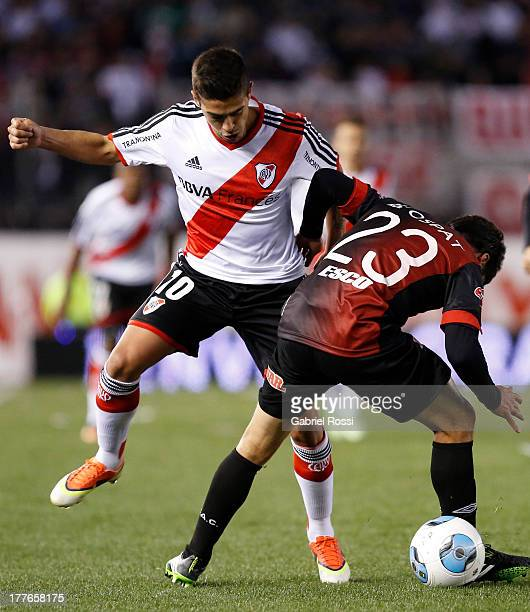 Manuel Lanzini of River Plate fights for the ball with Bruno Urribarri of Colon de Santa Fe during a match between River Plate and Colon de Santa Fe...