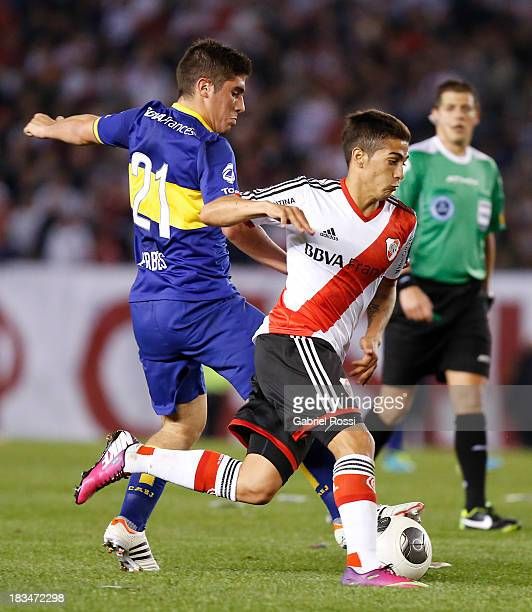 Manuel Lanzini of River Plate fights for the ball with Cristian Erbes of Boca Juniors during a match between River Plate and Boca Juniors as part of...