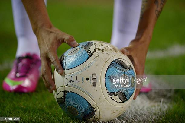 Manuel Lanzini of River Plate prepares the ball to kick a corner during a match between Lanus and River Plate as part of the Torneo Inicial 2013 at...