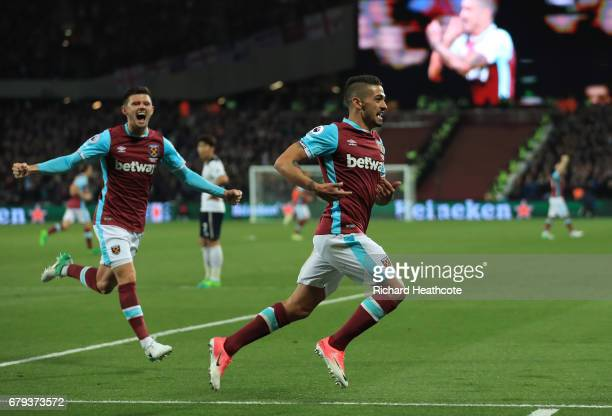 Manuel Lanzini of West Ham United celebrates after scoring the opening goal during the Premier League match between West Ham United and Tottenham...