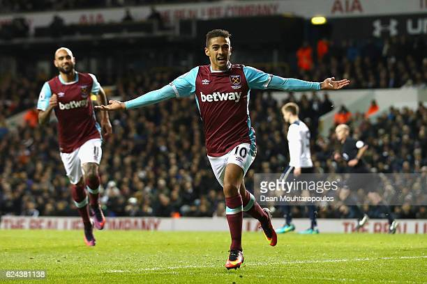 Manuel Lanzini of West Ham United celebrates scoring his sides second goal with his West Ham team mates during the Premier League match between...
