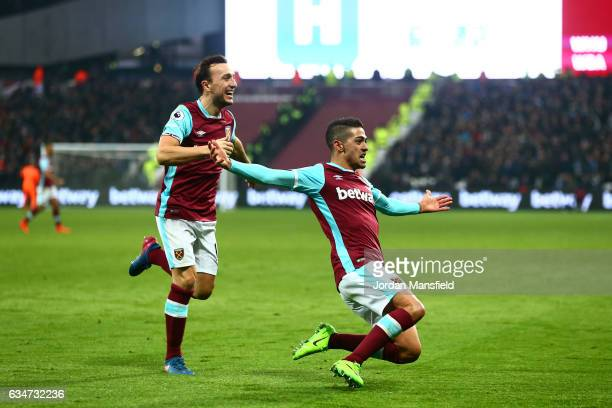 Manuel Lanzini of West Ham United celebrates scoring his side's second goal with his team mate Mark Noble during the Premier League match between...