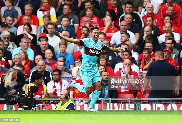 Manuel Lanzini of West Ham United celebrates scoring his team's first goal during the Barclays Premier League match between Liverpool and West Ham...