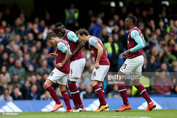 Manuel Lanzini of West Ham United celebrates scoring his team's first goal with his team mates Cheikhou Kouyate Mark Noble and Diafra Sakho during...