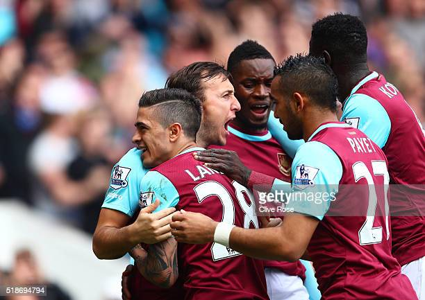 Manuel Lanzini of West Ham United celebrates scoring his team's first goal with his team mates during the Barclays Premier League match between West...