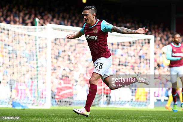 Manuel Lanzini of West Ham United celebrates scoring his team's first goal during the Barclays Premier League match between West Ham United and...