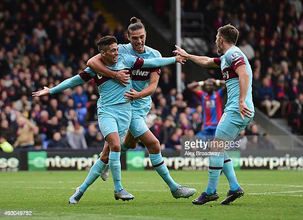 Manuel Lanzini of West Ham United celebrates scoring his team's second goal with his team mates Andy Carroll and Aaron Cresswell during the Barclays...