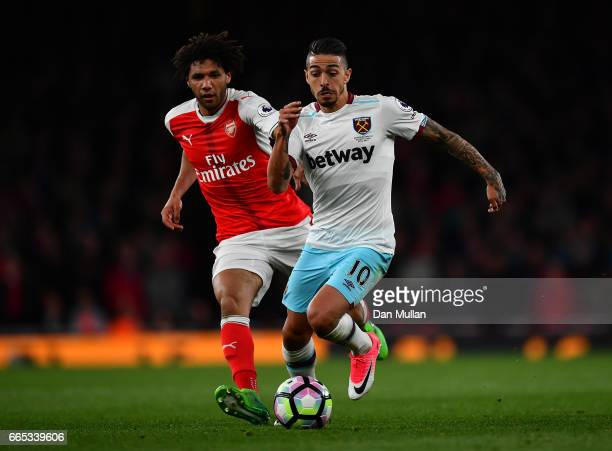 Manuel Lanzini of West Ham United holds off Mohamed Elneny of Arsenal during the Premier League match between Arsenal and West Ham United at Emirates...