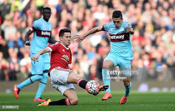 Manuel Lanzini of West Ham United is challenged by Ander Herrera of Manchester United during the Emirates FA Cup sixth round match between Manchester...