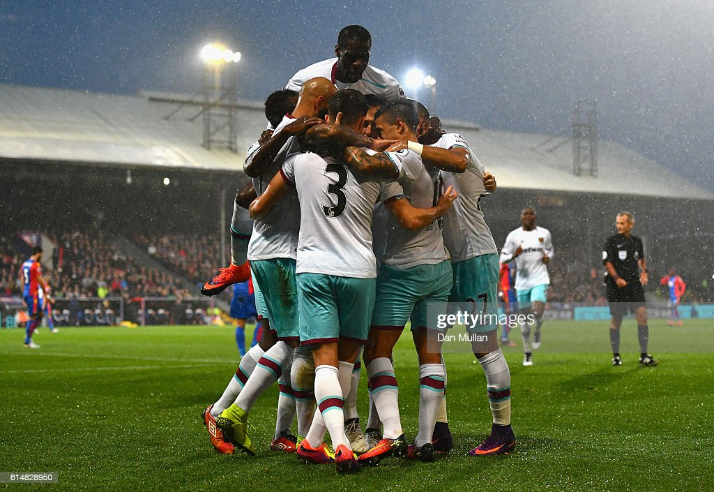 Manuel Lanzini of West Ham United is mobbed by team mates after scoring the opening goal during the Premier League match between Crystal Palace and West Ham United at Selhurst Park on October 15, 2016 in London, England.