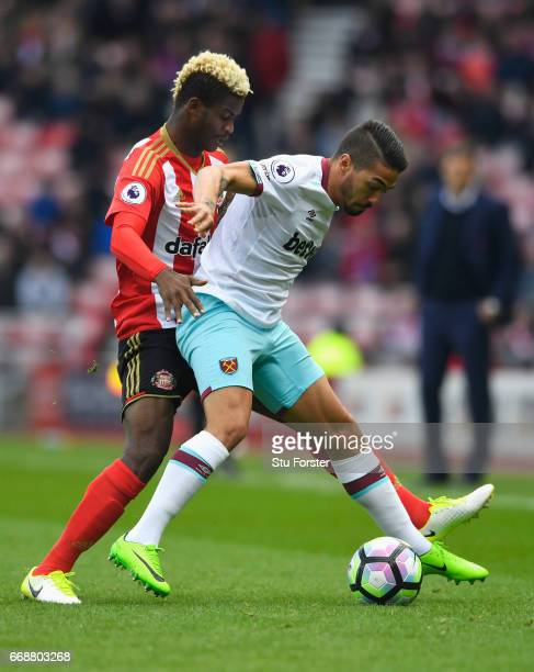 Manuel Lanzini of West Ham United is put under pressure from Dider N'dong of Sunderland during the Premier League match between Sunderland and West...