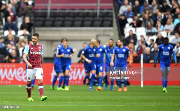 Manuel Lanzini of West Ham United looks dejected as Leicester City celebrate after Riyad Mahrez of Leicester City scores during the Premier League...