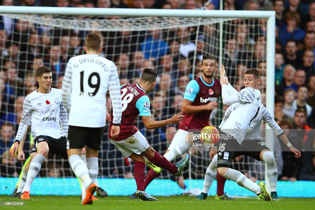 Manuel Lanzini (C) of West Ham United scores his team's first goal during the Barclays Premier League match between West Ham United and Everton at Boleyn Ground on November 7, 2015 in London, England.