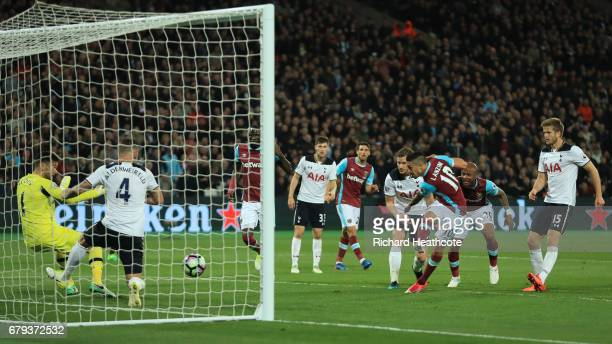 Manuel Lanzini of West Ham United scores the opening goal uring the Premier League match between West Ham United and Tottenham Hotspur at the London...