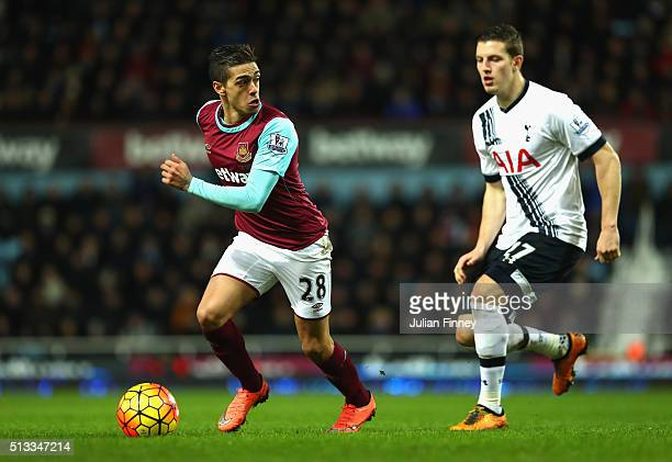 Manuel Lanzini of West Ham United takes on Kevin Wimmer of Tottenham Hotspur during the Barclays Premier League match between West Ham United and...