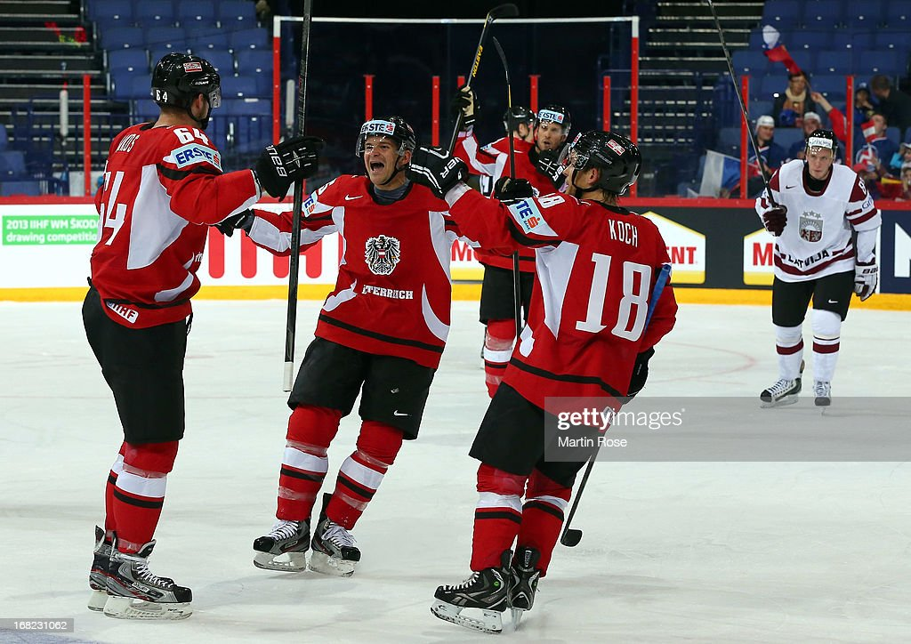Manuel Latusa (C) of Austria celebrate with his team mates the 2nd goal uring the IIHF World Championship group H match between Austria and Latvia at Hartwall Areena on May 7, 2013 in Helsinki, Finland.