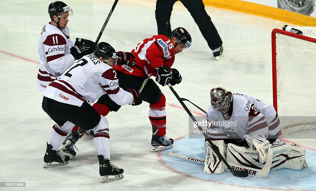 Manuel Latusa (#15) of Austria faisl to score over Edgars Masalskis (#31), goaltender of Latvia during the IIHF World Championship group H match between Austria and Latvia at Hartwall Areena on May 7, 2013 in Helsinki, Finland.
