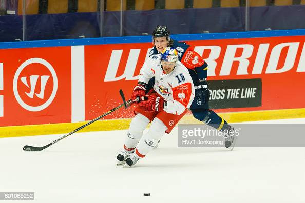 Manuel Latusa of Red Bull Salzburg focused on the puck with Erik Andersson of HV71 behinds him during the Champions Hockey League match between HV71...