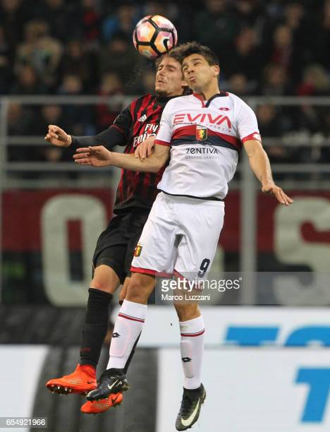 Manuel Locatelli of AC Milan competes for the ball with Giovanni Simeone of Genoa CFC during the Serie A match between AC Milan and Genoa CFC at...