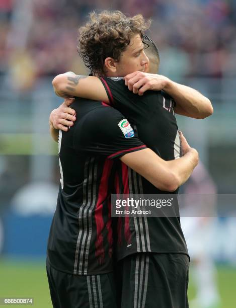Manuel Locatelli of AC Milan embraces Gianluca Lapadula of AC Milan during the Serie A match between AC Milan and US Citta di Palermo at Stadio...