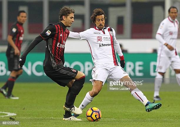 Manuel Locatelli of AC Milan is challenged by Davide Di Gennaro of Cagliari Calcio during the Serie A match between AC Milan and Cagliari Calcio at...