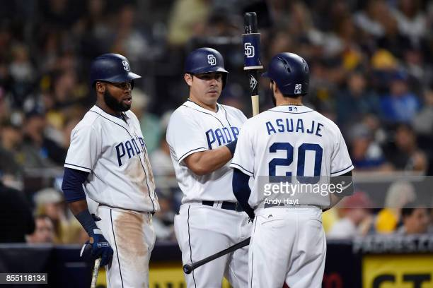 Manuel Margot Christian Villanueva and Carlos Asuage of the San Diego Padres talk during a pitching change during the game against the Colorado...