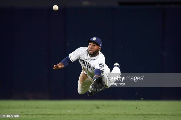 Manuel Margot of the San Diego Padres attempts a diving catch in center field during the game against the New York Mets at PETCO Park on July 25 2017...