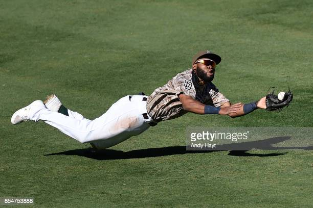 Manuel Margot of the San Diego Padres attempts a diving catch in center field during the game against the Colorado Rockies at Petco Park on September...