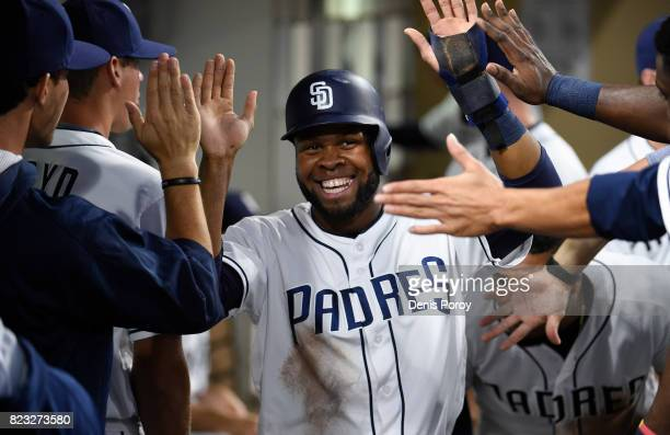 Manuel Margot of the San Diego Padres celebrates in the dugout after scoring in the third inning of a baseball game against the New York Mets at...