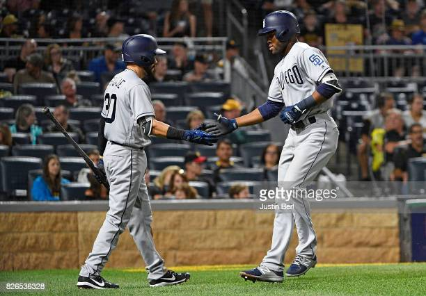Manuel Margot of the San Diego Padres celebrates with Carlos Asuaje after hitting a solo home run in the seventh inning during the game against the...