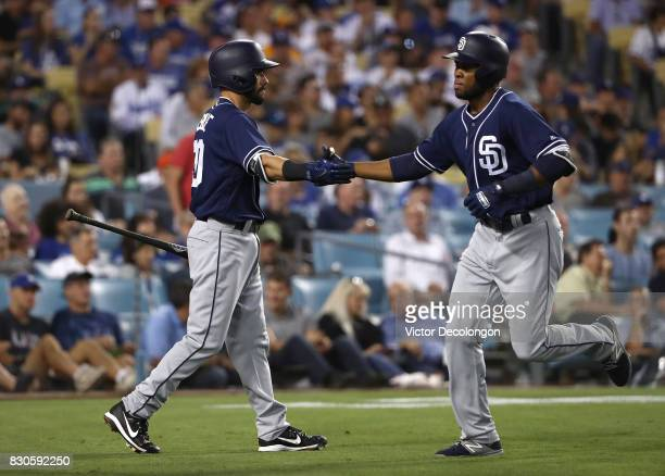 Manuel Margot of the San Diego Padres celebrates with teammate Carlos Asuaje after Margot hit a solo homerun in the third inning during the MLB game...
