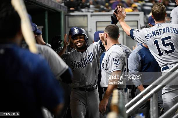 Manuel Margot of the San Diego Padres celebrates with teammates in the dugout after hitting a solo home run in the seventh inning during the game...