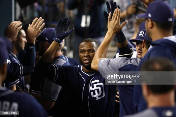 Manuel Margot of the San Diego Padres celebrates with teammates in the dugout after hitting his second homerun of the game during the seventh inning...