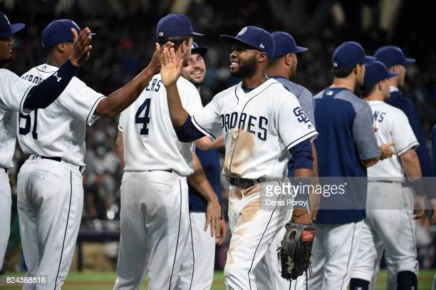 Manuel Margot of the San Diego Padres center is congratulated by after beating the Pittsburgh Pirates 42 in a baseball game at PETCO Park on July 29...