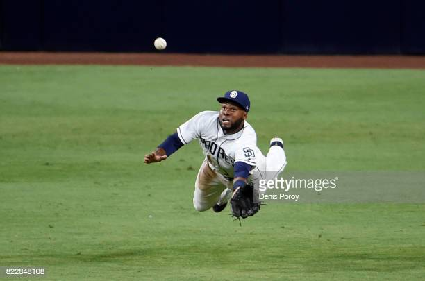 Manuel Margot of the San Diego Padres dives but can't make the catch on a double hit by Curtis Granderson of the New York Mets during the fifth...